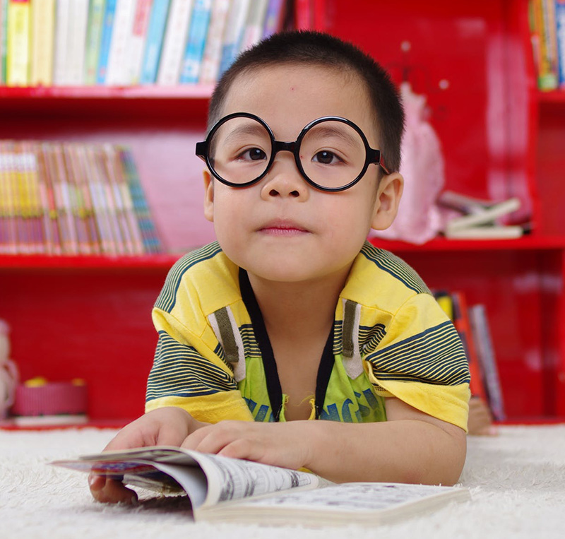 young boy with glasses